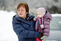 Grandmother and a girl at winter day Stock Photo