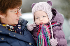 Grandmother and a girl at winter day Royalty Free Stock Photos