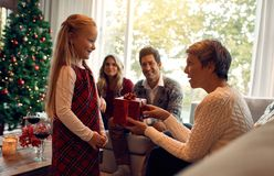 Grandmother giving Christmas gift to little girl Royalty Free Stock Photo