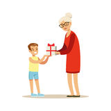 Grandmother giving gift box to her happy grandson colorful characters vector Illustration royalty free illustration