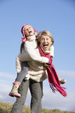 Grandmother Giving Her Granddaughter  Piggy Back Stock Image