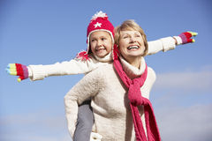 Grandmother Giving Her Granddaughter  Piggy Back Stock Photos