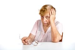 The grandmother with glasses in hands Stock Photography