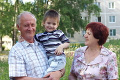 Grandmother and grand-dad with a grandchild Royalty Free Stock Photography