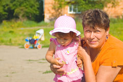The grandmother with the grand daughter. The girl than that is strongly surprised stock photography