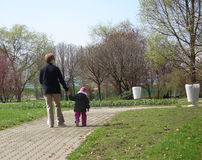 Grandmother with grand daughter. Walking on sunny day Stock Photos
