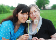 Grandmother and grand daughter with flowers Royalty Free Stock Image