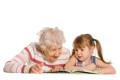 Grandmother with the grand daughter read Royalty Free Stock Photo