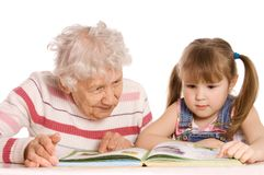 Grandmother with the grand daughter read Royalty Free Stock Photos