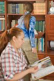 The grandmother and the grand daughter read books. Royalty Free Stock Photo