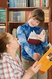 The grandmother and the grand daughter read books. Stock Image