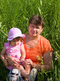 The grandmother with the grand daughter sit in a g Stock Images