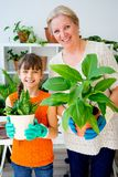 Grandmother and grandaughter. Are gardening together growing plants Royalty Free Stock Images