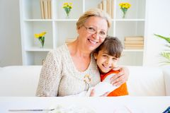 Grandmother and grandaughter. Are painting together at home Royalty Free Stock Photography
