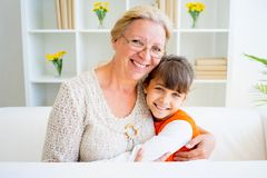Grandmother and grandaughter. Are painting together at home Stock Image