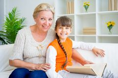 Grandmother and grandaughter. Are reading a book Royalty Free Stock Image