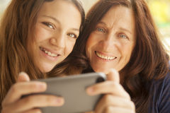 Grandmother and grandaughter with mobile phone Royalty Free Stock Images