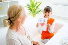 Grandmother and grandaughter. Are painting together at home Royalty Free Stock Photo