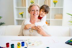 Grandmother and grandaughter. Are painting together at home Stock Photo