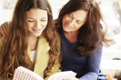 Grandmother and grandaughter reading Stock Photo