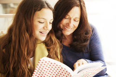Grandmother and grandaughter reading Royalty Free Stock Photos