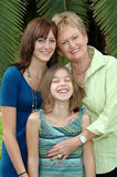 Grandmother and Grandaughters. The faces of a grandmother and her grandaughters Royalty Free Stock Images