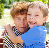 Grandmother with grandchild. Old women with grandson stock photos