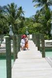Grandmother with grandchild. Grandmother hugging granddaughter on pier, Florida, U.S.A Stock Photo