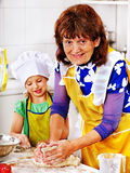 Grandmother and grandchild baking cookies. Stock Photo