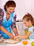 Grandmother and grandchild baking cookies. Royalty Free Stock Photo