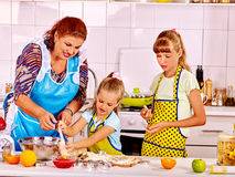 Grandmother and grandchild baking cookies Stock Images