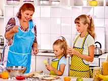 Grandmother and grandchild baking cookies. Grandmother and granddaughter baking cookies. Cooking at kitchen Royalty Free Stock Photos