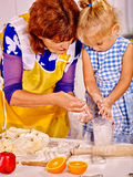 Grandmother and grandchild baking cookies Royalty Free Stock Photo