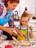 Grandmother and grandchild baking cookies Stock Photography
