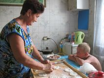 Grandmother and grandchild cooking. At home Royalty Free Stock Photo