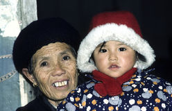 Grandmother and grandchild in Gueillin. GUEILLIN, CHINA - DEC 30, 1985: proud grandmother poses with her granddaughter in Gueillin, China Stock Photo