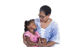 Grandmother and grandchild. Grandmother and her grandchild on white stock photos