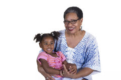 Grandmother and grandchild. Grandmother and her grandchild on white royalty free stock photography