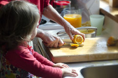Grandmother and Grandchild in Kitchen Stock Photo