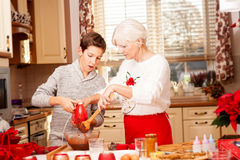 Grandmother with grandchild in kitchen, christmas. Royalty Free Stock Image