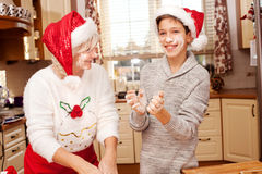 Grandmother with grandchild in kitchen, christmas. Smiling grandmother baking cookies with young grandchild. Christmas time. Happiness content Stock Photos