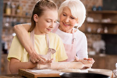 Grandmother and grandchild kneading dough Royalty Free Stock Images