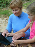 Grandmother, grandchild with laptop Stock Images