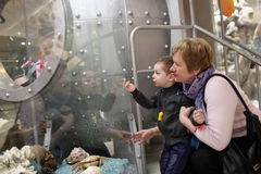 Grandmother with grandchild in museum Stock Photo