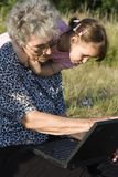 Grandmother and grandchild by notebook Royalty Free Stock Photo