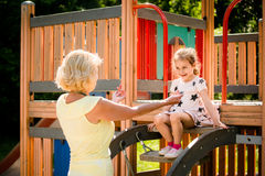 Grandmother with grandchild in playground Stock Photography