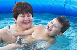 Grandmother  with a grandchild  in a pool Stock Image