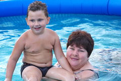 Grandmother  with a grandchild  in a pool Royalty Free Stock Image