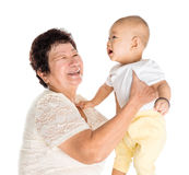 Grandmother and grandchild portrait. Asian grandmother and grandchild portrait, isolated on white background stock photos