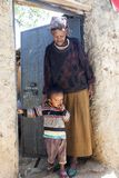 Grandmother with grandchild posing in entrance of their house in city of Jugol. Harar. Ethiopia. Stock Image